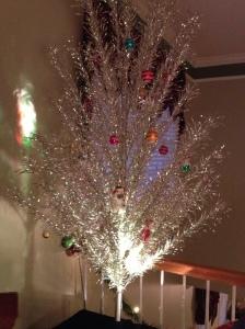 silver tree in foyer